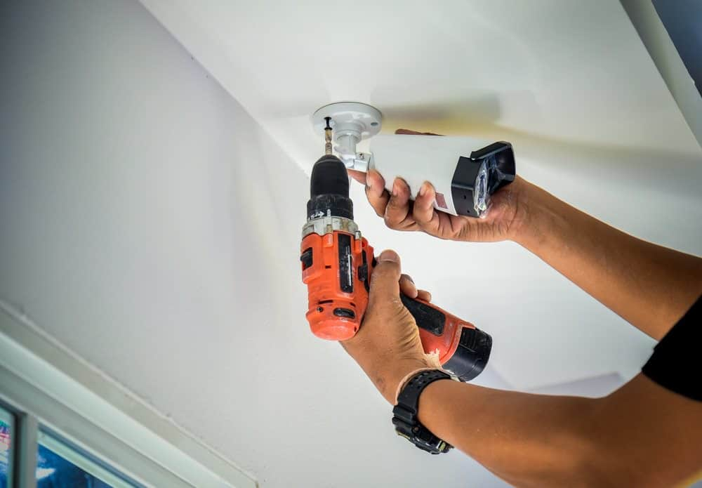 A technician installing a CCTV camera in Newcastle